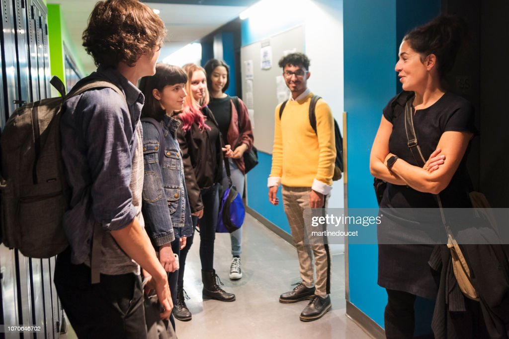 Multi-ethnic group of students hanging in College hall. : Stock Photo