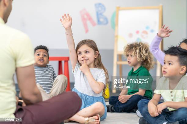 multi-ethnic group of students in class - montessori education stock pictures, royalty-free photos & images