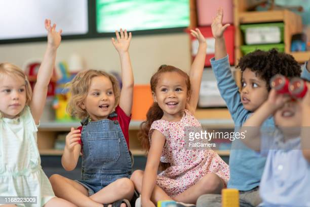 multi-ethnic group of students in class - preschool age stock pictures, royalty-free photos & images
