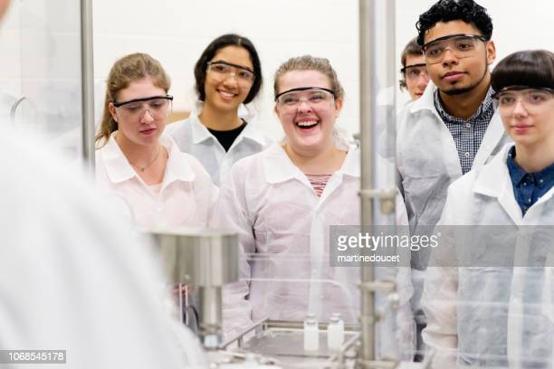 Multi-ethnic group of students in College pharmaceutical laboratory.