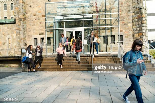 "multi-ethnic group of students in front of college university entrance. - ""martine doucet"" or martinedoucet stock pictures, royalty-free photos & images"