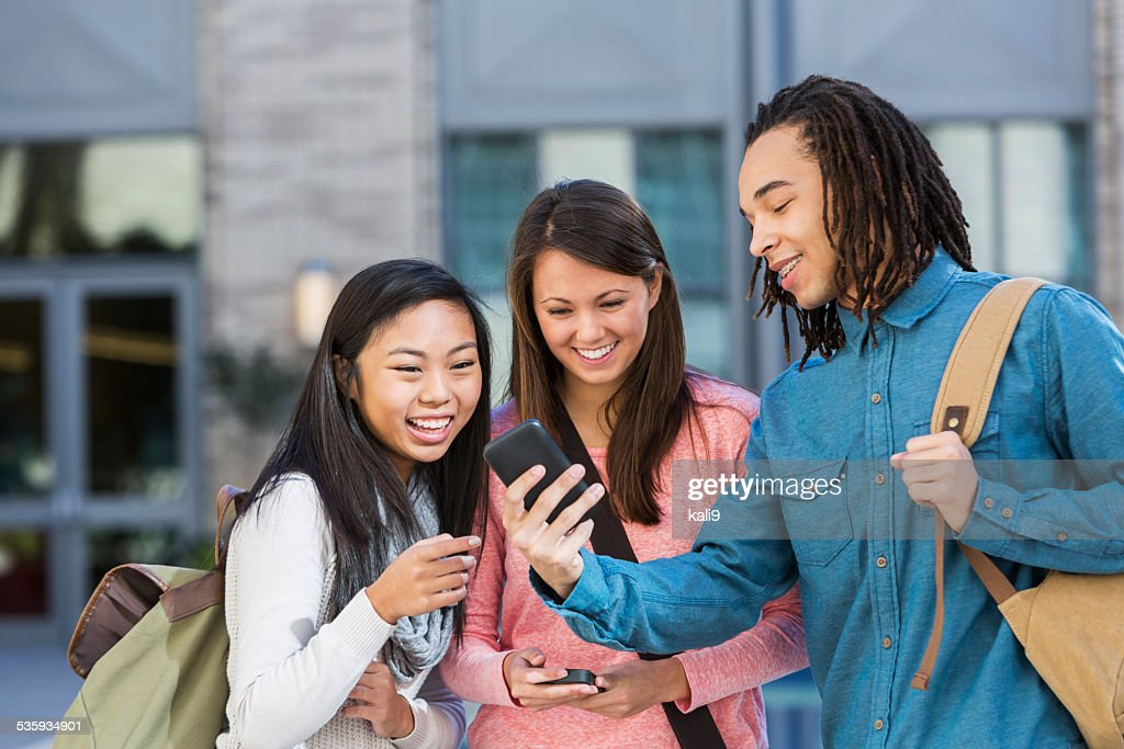 Multi-ethnic group of students outdoors : Stock Photo