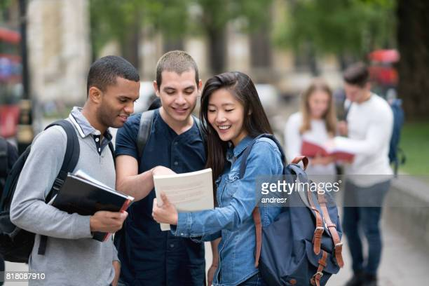 multi-ethnic group of students studying outdoors - college student stock pictures, royalty-free photos & images