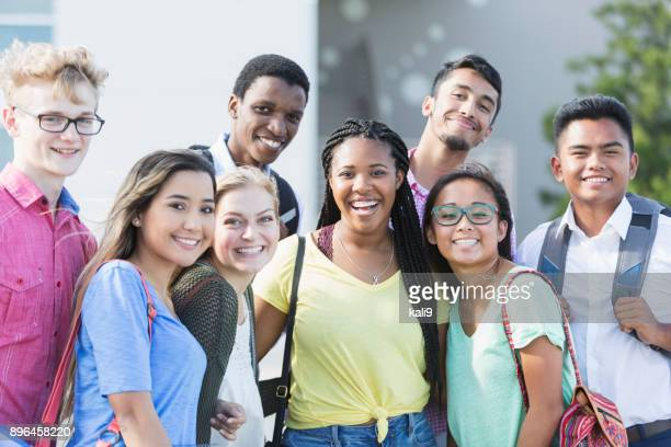 multi-ethnic group of teenagers at school, outdoors - multiracial group stock pictures, royalty-free photos & images