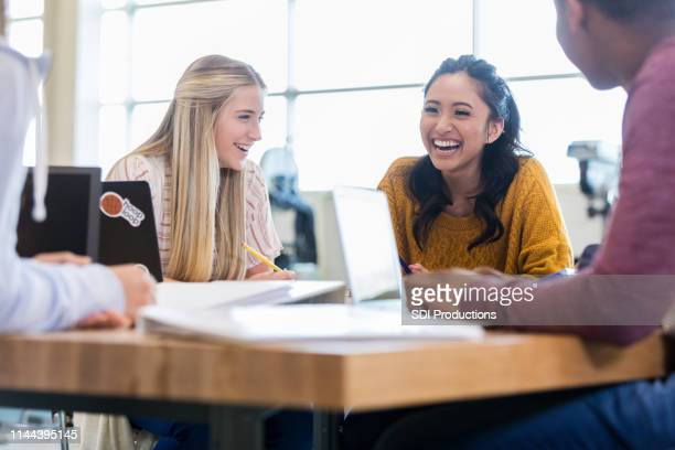 multi-ethnic group of teenagers takes a break - high school building stock pictures, royalty-free photos & images