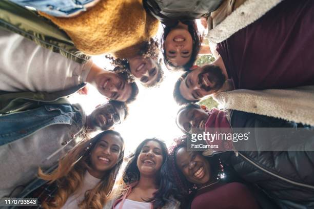 multi-ethnic group of university students looking down - cultures stock pictures, royalty-free photos & images