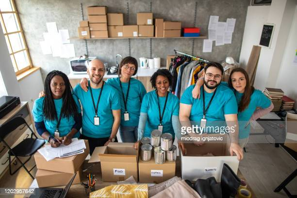 multi-ethnic group of volunteers - non profit organization stock pictures, royalty-free photos & images