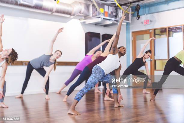 multi-ethnic group of women doing barre workout - hair conditioner stock photos and pictures