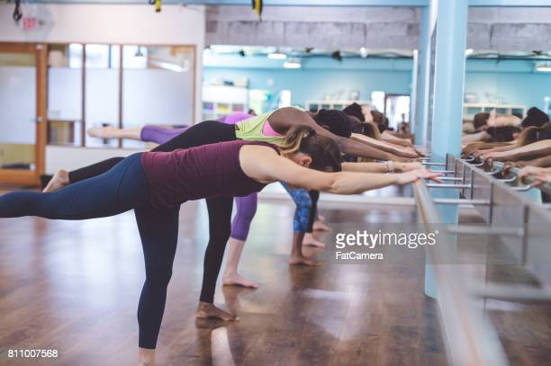 multi-ethnic group of women doing barre workout - leg waxing stock pictures, royalty-free photos & images
