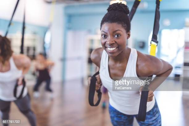 multi-ethnic group of women doing workout - fat lady in leggings stock photos and pictures