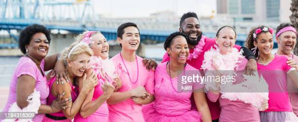 multi-ethnic group of women, men at breast cancer rally - boa stock pictures, royalty-free photos & images