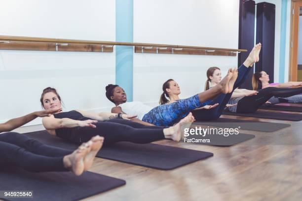 Multiethnic group of women work out together in a modern health club