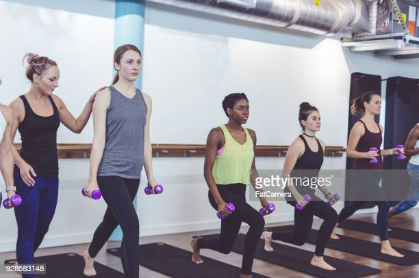 Multiethnic group of women work out together in a modern workout facility