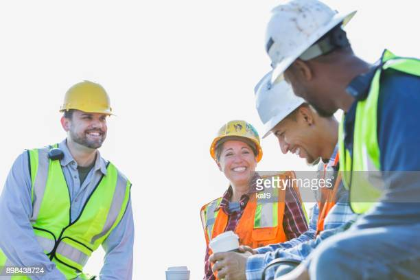 multi-ethnic group of workers taking coffee break - dock worker stock photos and pictures