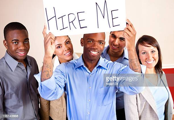 Multi-ethnic group of young adults. Business people. 'Hire Me' Sign.
