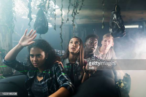 multi-ethnic group of young adults in haunted house - halloween scary stock pictures, royalty-free photos & images