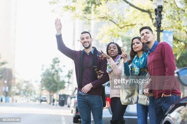 multi-ethnic group of young adults waiting for ride - car pooling stock photos and pictures
