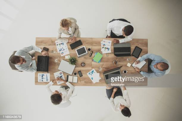 multi-ethnic group on meeting in conference room - medium group of people stock pictures, royalty-free photos & images