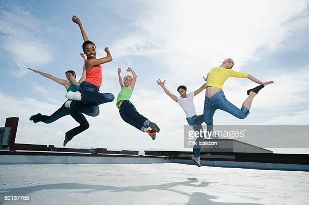 Multi-ethnic group performing modern dance