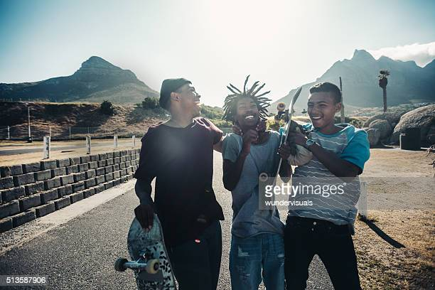 Multi-Ethnic Group Skaters Laughing Together at Seaside