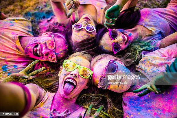 multi-ethnic group taking a selfie at holi festival - holi stock pictures, royalty-free photos & images