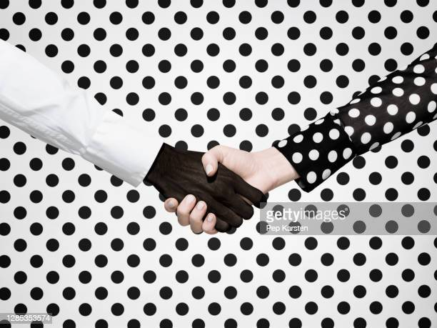 multiethnic handshake on polka dot background - printed sleeve stock pictures, royalty-free photos & images