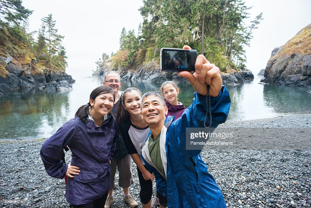 Multi-Ethnic Hiking Family Posing for Selfie on Remote Wilderness Beach : Stock Photo