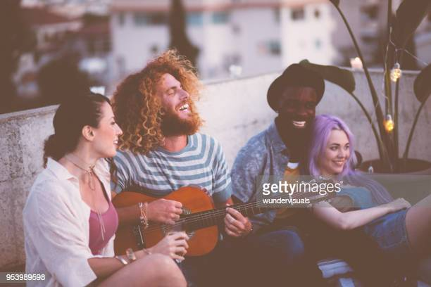 multi-ethnic hipster couples singing and having fun at rooftop party - purple hair stock photos and pictures