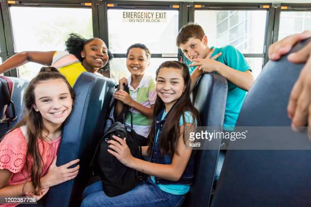 multi-ethnic junior high students riding school bus - aluna da escola secundária imagens e fotografias de stock