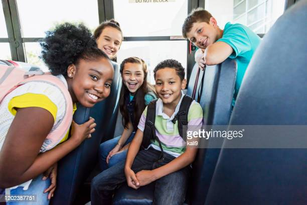 multi-ethnic junior high students riding school bus - 11 stock pictures, royalty-free photos & images