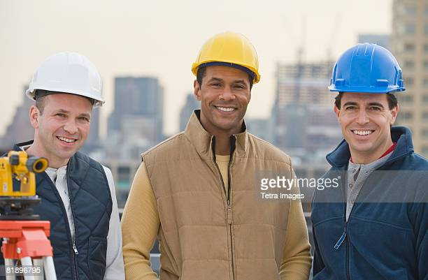 Multi-ethnic male construction workers wearing hard hats