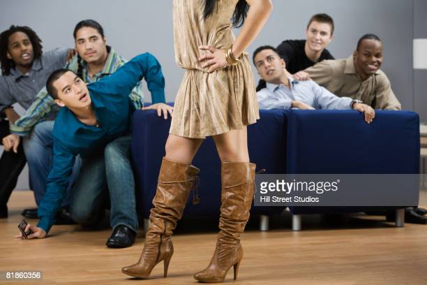 Multi-ethnic men looking at woman