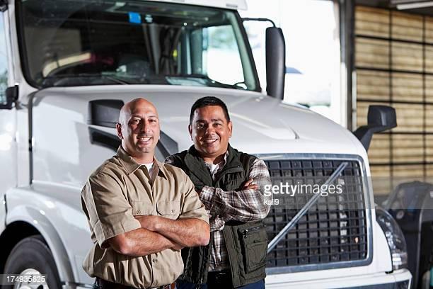 multi-ethnic men standing next to semi-truck - loading dock stock pictures, royalty-free photos & images