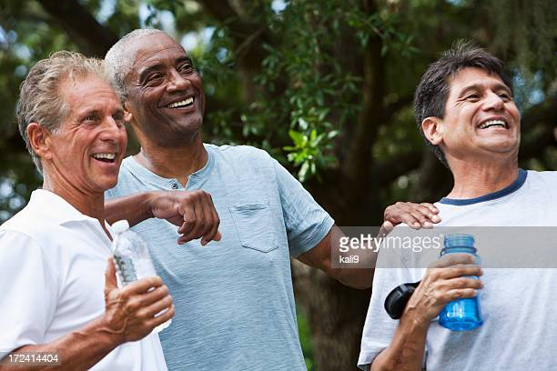 Multi-ethnic men taking break from exercising