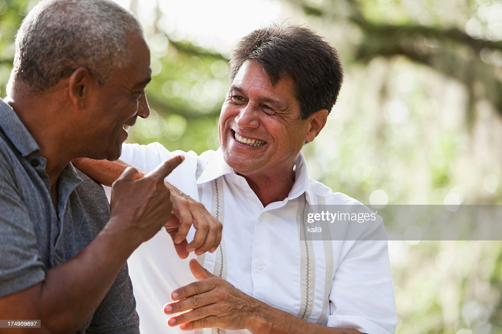 Multi-ethnic men talking : Stock Photo