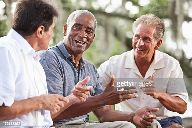 Multi-ethnic men talking