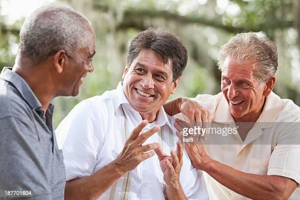 multi-ethnic men talking - only senior men stock pictures, royalty-free photos & images