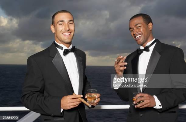 multi-ethnic men wearing tuxedos - tuxedo stock pictures, royalty-free photos & images