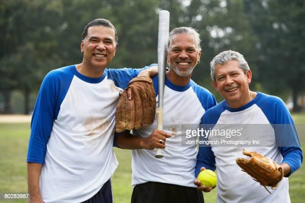 Multi-ethnic men with baseball gear
