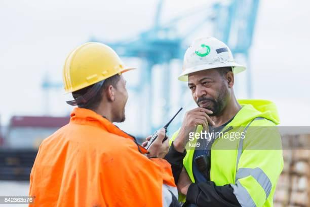 Multi-ethnic men working at shipping port