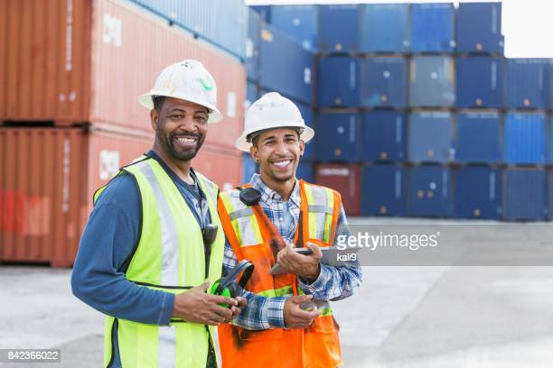 multi-ethnic men working at shipping port - longshoremen stock pictures, royalty-free photos & images