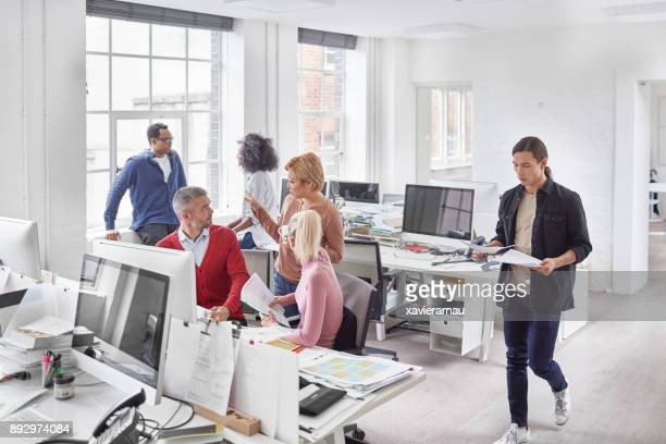 Multi-ethnic millennial business people working at office