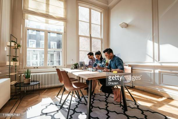 multi-ethnic millennial business team working on cryptocurrency project. - employee engagement stock pictures, royalty-free photos & images