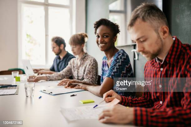 multi-ethnic millennial teamwork working in coworking space - eastern european descent stock pictures, royalty-free photos & images
