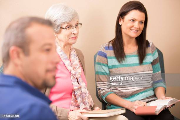 multi-ethnic, mixed age bible study group. - book club meeting stock pictures, royalty-free photos & images