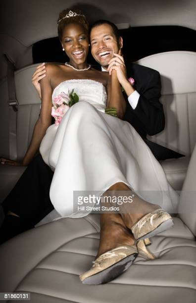 multi-ethnic newlyweds in back of limousine - gardena california stock pictures, royalty-free photos & images