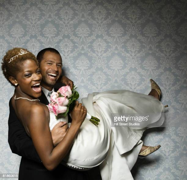 Multi-ethnic newlyweds laughing