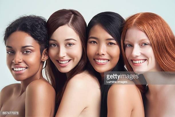 Multi-ethnic nude women posing together