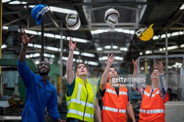 multi-ethnic of factory workers working success. production or business achieve target. - may day international workers day stock pictures, royalty-free photos & images
