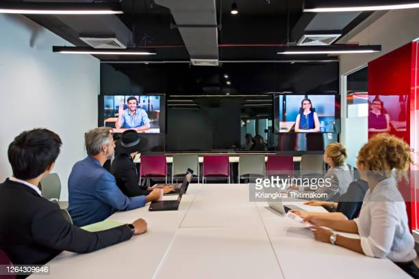 multi-ethnic people teleconferencing at work. - employee engagement stock pictures, royalty-free photos & images